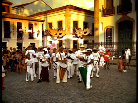a group of men play conga drums in a city plaza in brazil. - brazilian ethnicity stock videos & royalty-free footage