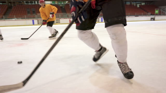group of men playing ice hockey match in ice hockey rink. - turno sportivo video stock e b–roll