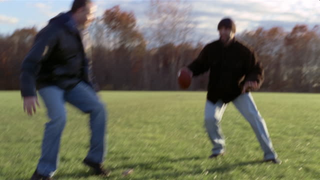 group of men playing touch football in field - touch football stock videos & royalty-free footage