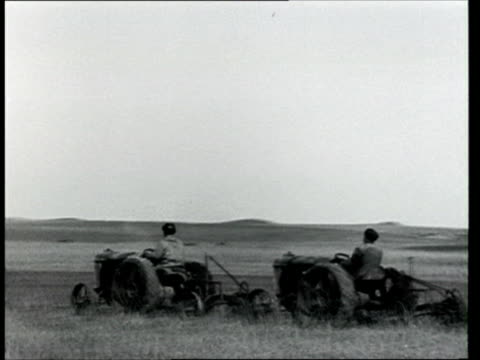 1925 MONTAGE B/W Group of men ploughing field during a period of agricultural reform and the development of the collective farming policy or 'kolkhoz' in the Soviet Union/ Russia