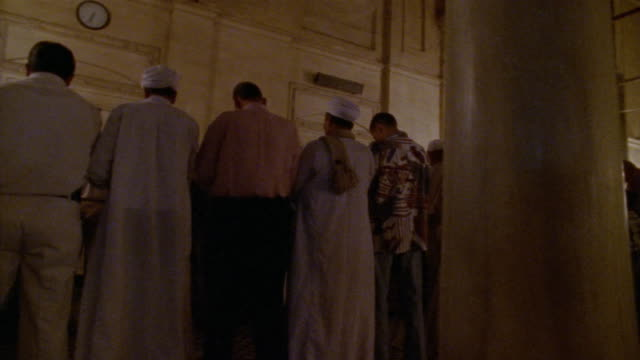 ms, ds, group of men praying in sultan hassan mosque, rear view, cairo, egypt - madressa stock videos and b-roll footage