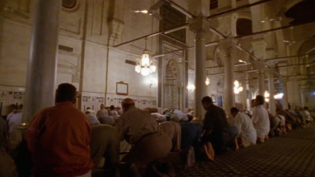 ms, pan, group of men praying in sultan hassan mosque, rear view, cairo, egypt - madressa stock videos and b-roll footage