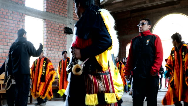 Group of men prepare for a traditional Andean ceremony in Cusco Pero on 26th of May