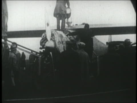 b/w 1927 group of men preparing spirit of st louis for flight in ny - 1927 stock videos & royalty-free footage