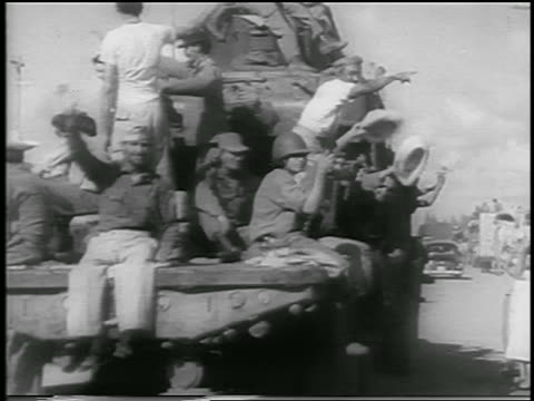 view group of men riding truck on dirt road past cheering crowd / havana / newsreel - 1959 stock-videos und b-roll-filmmaterial