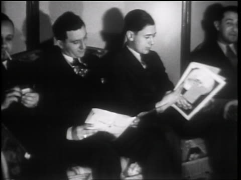 b/w 1931 pan group of men sitting + reading magazines in beauty shop / toledo, ohio / newsreel - magazine stock videos & royalty-free footage