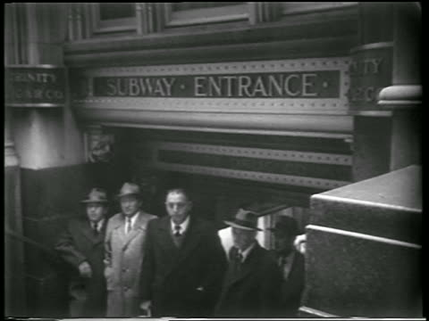 group of men stand in subway station entrance during civil defense drill / close up man in helmet - 1951 bildbanksvideor och videomaterial från bakom kulisserna