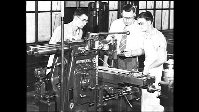 group of men standing around the table looking at blueprints, rows of workers working in the background; busy factory full of workers and assembly... - graph stock videos & royalty-free footage
