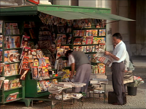 group of men standing at newspaper stand on street / lisbon, portugal - magazine publication stock videos & royalty-free footage