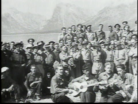 group of men standing together waving at camera some playing instruments / medium group spells out ccc then dispersing - civilian conservation corps video stock e b–roll