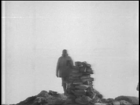 group of men surround cairn left by amundsen near south pole + remove hats in honor - 1920 1929 stock videos & royalty-free footage