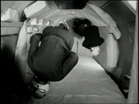 vídeos y material grabado en eventos de stock de group of men turn somersaults in the vomit comet airplane during a zero gravity test. - gravedad cero