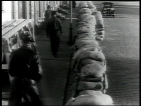 finland group of men walking together on street sandbags piled along sidewalk people going down into bomb shelter finland army ski soldiers tank... - battle stock videos & royalty-free footage