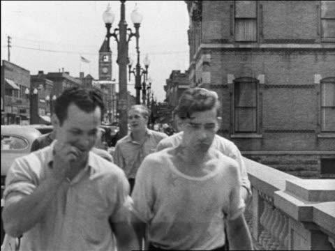 b/w 1944 group of men + women walking on bridge / educational - 1944 stock videos and b-roll footage