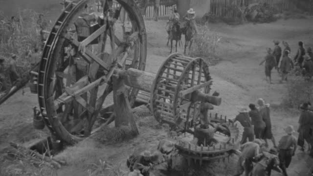 ms group of men working at huge water-wheel - watermill stock videos and b-roll footage