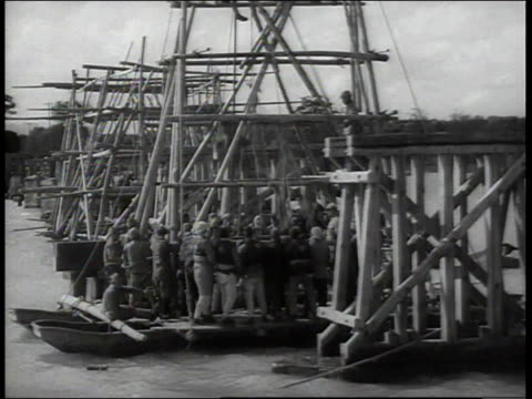stockvideo's en b-roll-footage met 1938 ls a group of men working on a dock / china - 1938