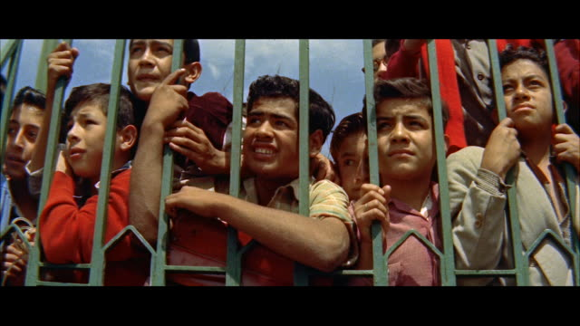 ms group of mexican boys looking through iron fence / mexico - separation stock videos and b-roll footage