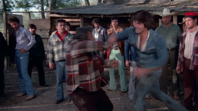 a group of mexican immigrants fight over a job in the 1970s dramatization - 1970 1979 stock videos & royalty-free footage