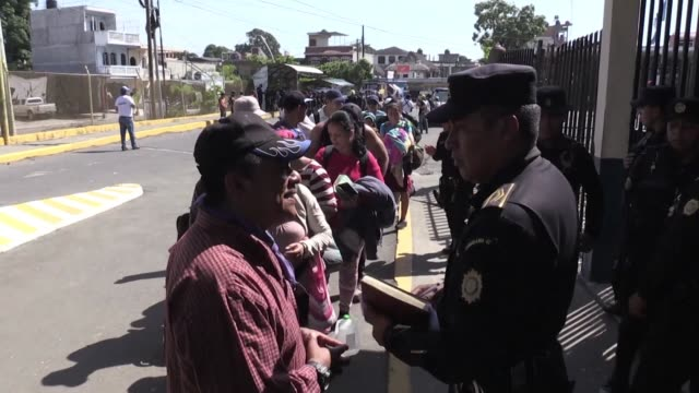 group of migrants from el salvador express joy at being allowed to enter mexico from guatemala legally with the mexican consul in guatemala saying... - mexican american stock videos & royalty-free footage