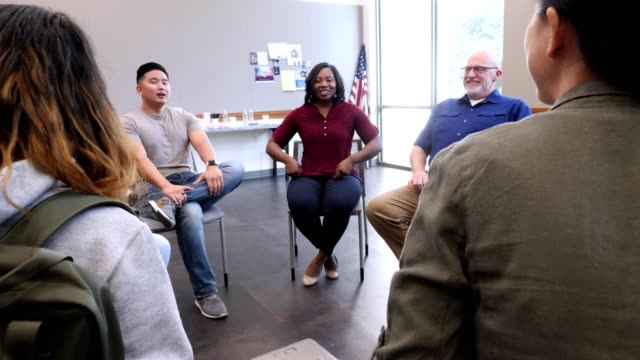 group of military veterans prepare for support group meeting - post traumatic stress disorder stock videos and b-roll footage