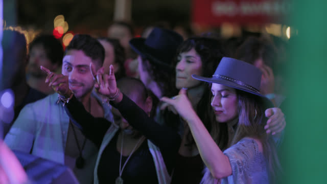 group of millennial hipsters dance in the front row of a popular music festival - beatnik stock videos & royalty-free footage