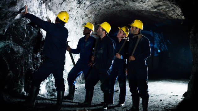 group of miners working at a mine - minatore video stock e b–roll
