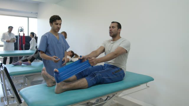 group of mixed age range patients during physiotherapy at a clinic - mixed age range stock videos & royalty-free footage
