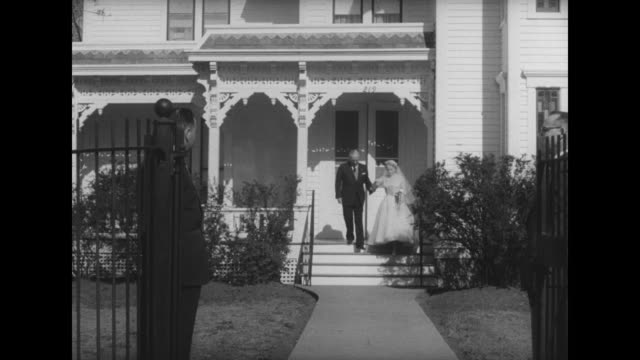 stockvideo's en b-roll-footage met ws group of mostly women smile and wave behind fence outside of former us president harry truman's home in independence missouri / ws bride margaret... - margaret truman