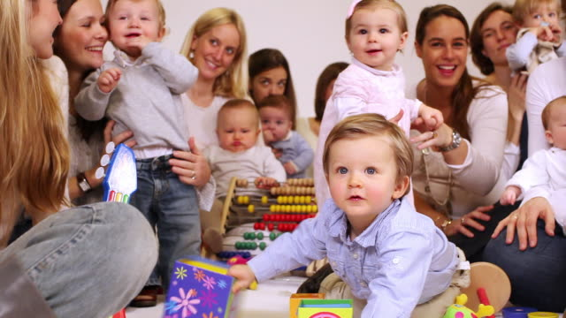 ms pan group of mothers and babies (2-23 months) / brussels, belgium - large group of people stock videos & royalty-free footage