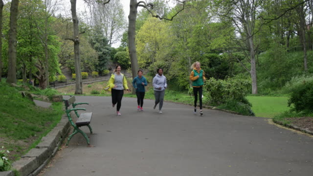 group of mothers exercising in the park - jogging stock videos & royalty-free footage