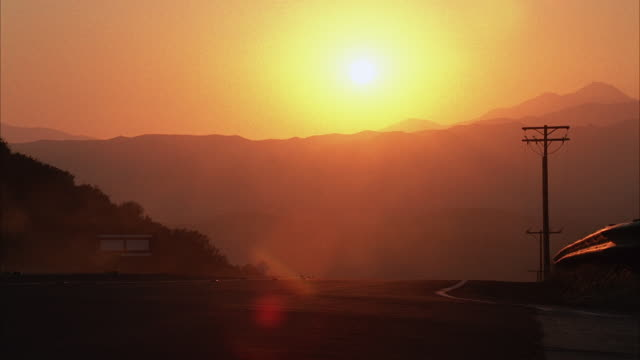 ws group of motorcyclists riding on rural mountain highway at sunset - biker gang stock videos & royalty-free footage