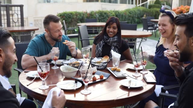 group of multi ethnic arab friends lunch in a restaurant in dubai - dining stock videos & royalty-free footage