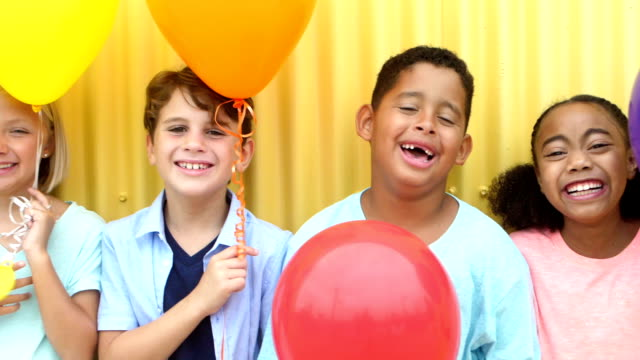 group of multi-ethnic children laughing, standing in row - 8 9 years stock videos & royalty-free footage