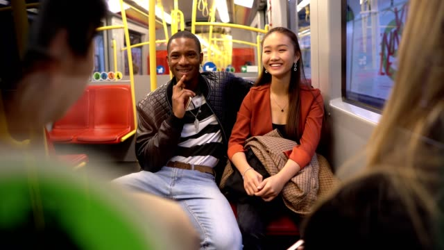 group of multi-ethnic friends traveling by train - quartet stock videos & royalty-free footage