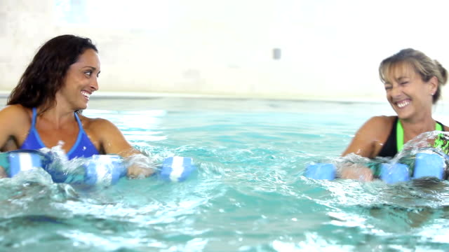 group of multiracial  women in water aerobics class - exercise class stock videos & royalty-free footage