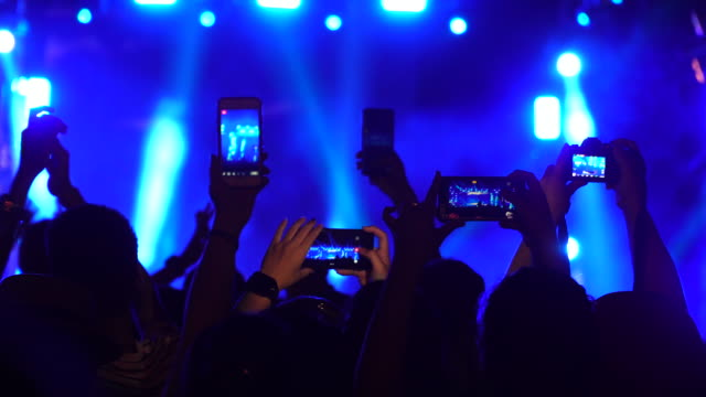 group of music fans recording concert with mobile phones - spettatore video stock e b–roll