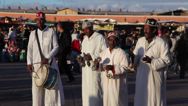 A group of musicians play instruments at the Jamaa el-Fna.
