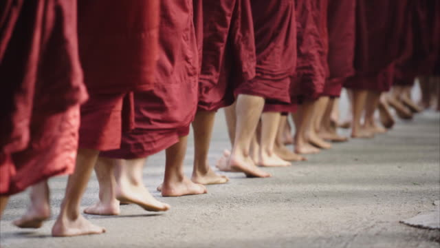 group of myanmar monks feet walking in line - monk stock videos & royalty-free footage