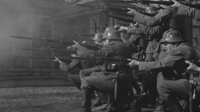 ms pan group of nazi soldiers firing in small town - german military stock videos & royalty-free footage