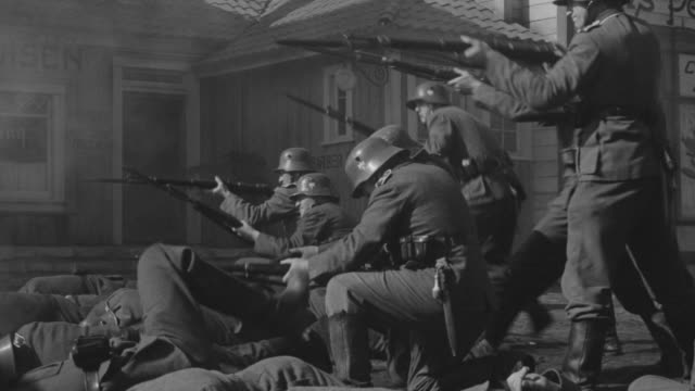 MS Group of Nazi soldiers firing in small town