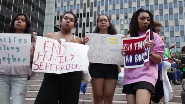 a group of new yorkers protest against the us immigration policy of deportation using suitcases as a symbol - deportation stock videos & royalty-free footage