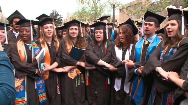 wgn a group of notre dame graduates walked out of their graduation ceremony on may 21 2017 in protest against vice president mike pence and his... - mortar board stock videos & royalty-free footage