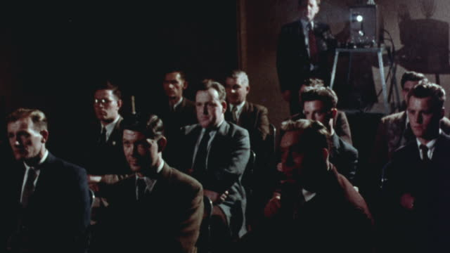 1957 montage group of nuclear technicians watching a video showing the explosion of an american nuclear power plant following deliberate criticality / united kingdom - 1957 stock videos & royalty-free footage