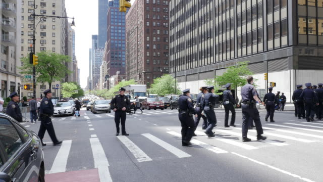 Group of NYPD police officier crossing street in New York City