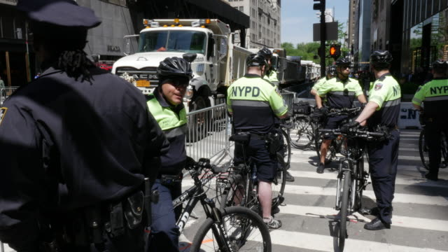 Group of NYPD police officier riding bike patroling in New York City