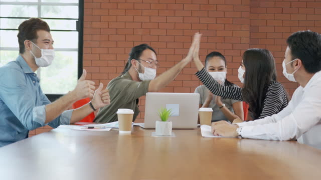 group of office workers meeting and wearing face mask in office to protect covid-19 - east asian ethnicity stock videos & royalty-free footage