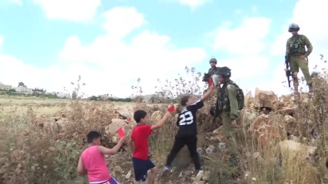 a group of palestinian children gather to asking fifa to suspend israel from world football in ramallah west bank on may 29 2015 they hold... - palestinian flag stock videos & royalty-free footage