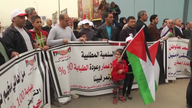 a group of palestinian refugees gather in front of the united nations relief and works agency for palestine refugees in the near east office to hold... - fordern stock-videos und b-roll-filmmaterial