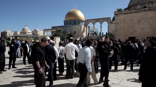 a group of palestinians protested outside the dome of the rock mosque in jerusalems old city on sunday after jewish visitors entered the al aqsa... - compounding stock videos and b-roll footage