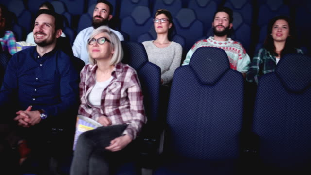 Group of people are in cinema and watching movie